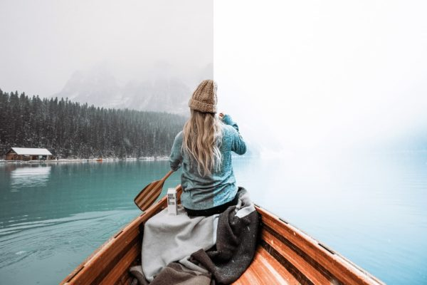 girl in a boat on a lake with winter lightroom preset from anagram design